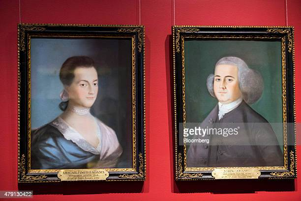 Paintings of former US President John Adams right and his wife Abigail Adams are displayed at the Massachusetts Historical Society in Boston...