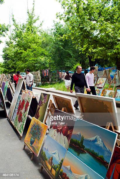 Paintings of Mount Ararat and Noahs Ark at the Vernissage weekend flea market in Yerevan Armenia Stretching for hundreds of meters people gather to...