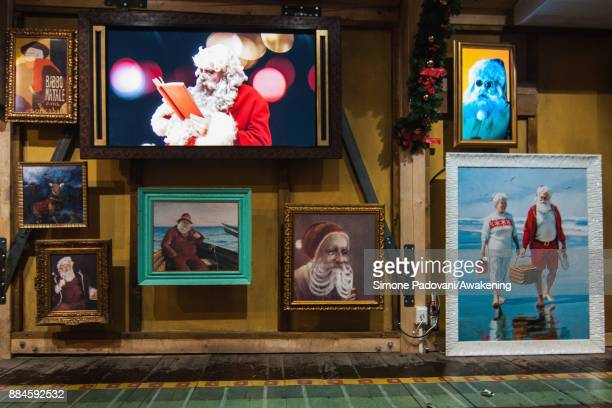 Paintings of Santa Claus are seen in the Reggia of Venaria on December 2 2017 in Turin Italy
