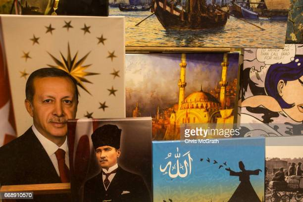 Paintings of Turkish President Recep Tayyip Erdogan and the founder of modern Turkey Mustafa Kemal Ataturk are seen in a shop window on April 15 2017...