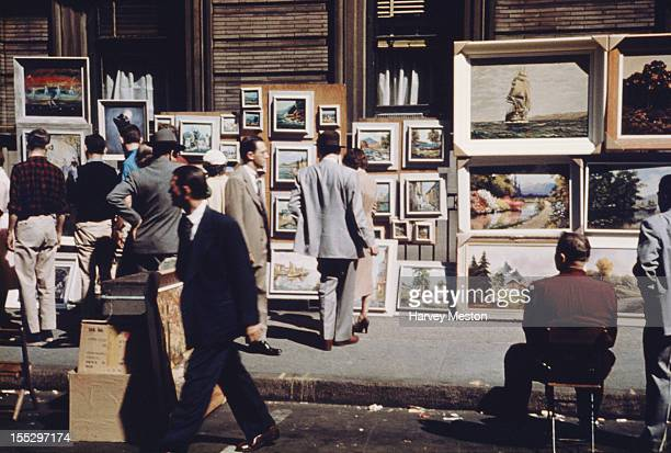 Paintings on display on the sidewalk in Greenwich Village New York City circa 1960