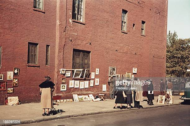 Paintings on display on the sidewalk in Greenwich Village New York City circa 1935