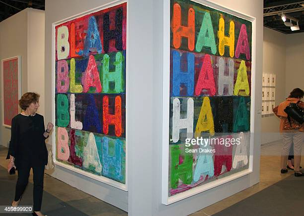 Paintings titled Blah Blah Blah and Ha Ha Ha by Mel Bochner are displayed during the Art Basel Miami Beach at Two Palms Gallery on December 03 2014...