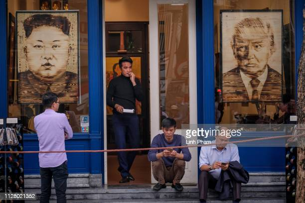 Paintings with the faces of North Korean leader Kim Jong Un and US President Donald Trump are on display at local stores during the summit on...