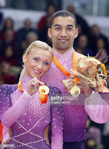 Pair free skating gold medalists Germany's Aliona Savchenko and Robin Szolkowy show their medals on the podium during the ISU Grand Prix figure...