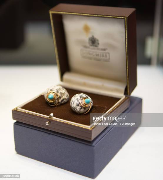 A pair of 18 carat gold and shell ear clips by David Webb are part of the Famous and Infamous exhibition which includes highlights from the...