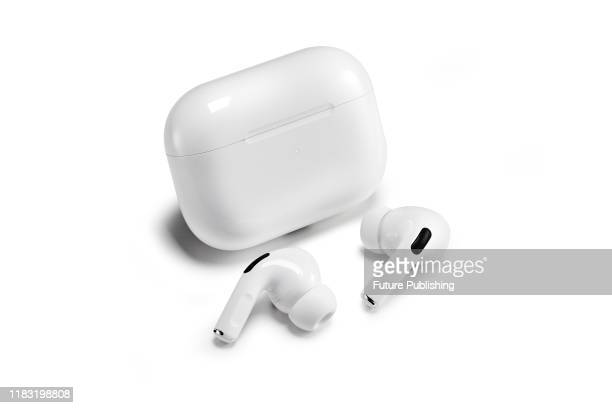 A pair of 2019 Apple AirPod Pro noisecancelling earphones and a wireless charging case taken on November 5 2019