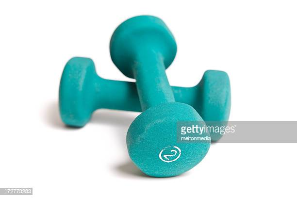 A pair of 2-lb green dumbbells on white background
