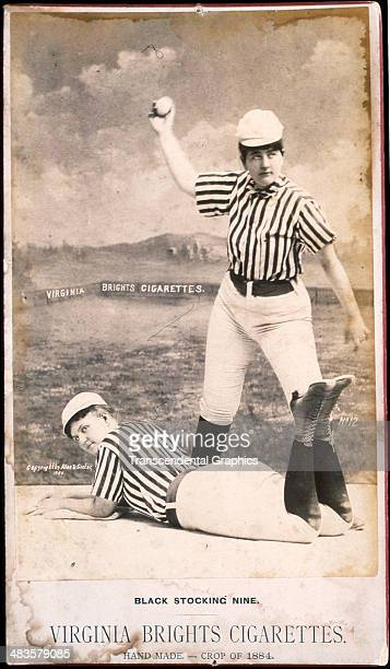 A pair of actresses in baseball uniforms pose for a cigarette premium photo in 1884 in New York City
