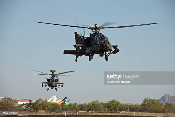 A pair of AH-64D Apache Longbow helicopters taking off on a mission in support of exercise Angel Thunder 2013.