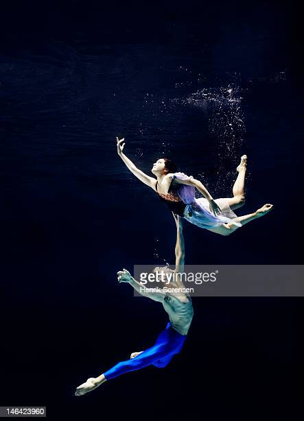 pair of ballet dancers underwater
