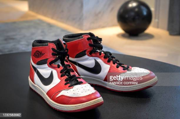 Pair of basketball legend Michael Jordan's famous Air Jordans from his rookie season are seen on April 28, 2021 in Geneva during a preview of sale by...