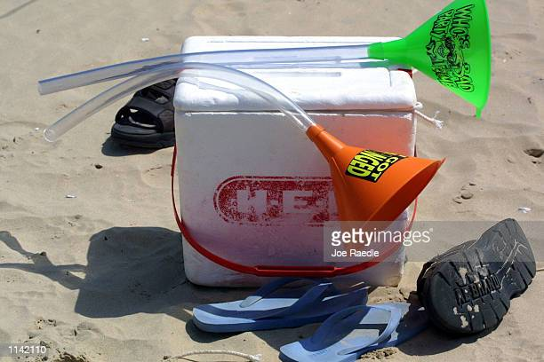 A pair of beer funnels rest on top of a cooler on the beach at South Padre Island Texas March 16 2001 during the annual rite of Spring Break Some...