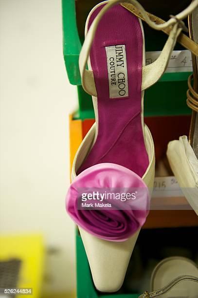 Pair of bespoke Jimmy Choo shoes hangs on display in his studio on Cannaught Street.