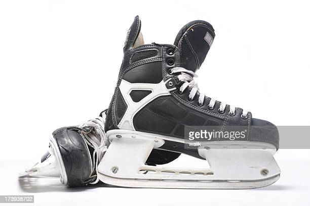 a pair of black and silver ice skates on a white background - ice skate stock pictures, royalty-free photos & images