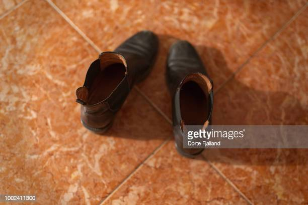 Pair of black boots on a tiled floor