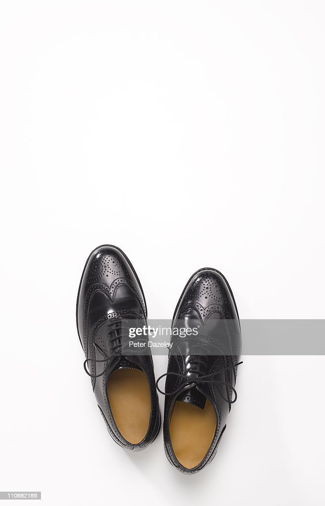 Pair of black brogue shoes with copy space : Stock Photo