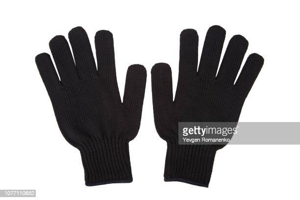 pair of black knit gloves isolated on white background - mitten stock pictures, royalty-free photos & images