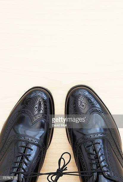 pair of black lace-up shoes tied together, overhead view - brogue stock pictures, royalty-free photos & images