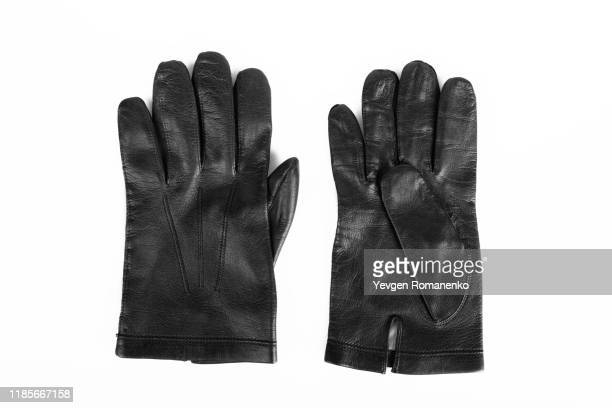 pair of black leather gloves isolated on white background - leather glove stock pictures, royalty-free photos & images