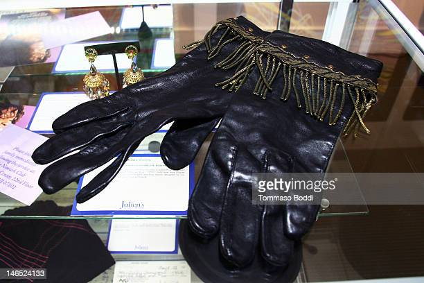 A pair of black leather gloves worn by Whitney Houston in her video for the song 'The Greatest Love of All' is displayed at the Julien's Auctions...