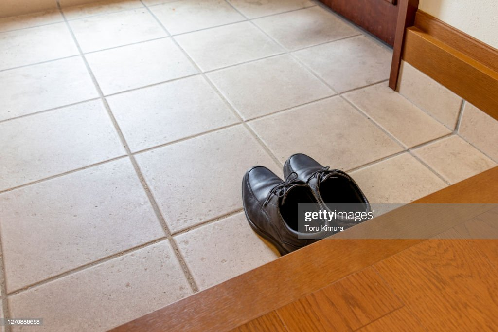 A pair of black shoes placed at the entrance : Stock Photo