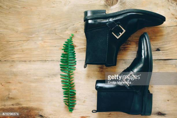 pair of black woman shoes - black boot stock pictures, royalty-free photos & images