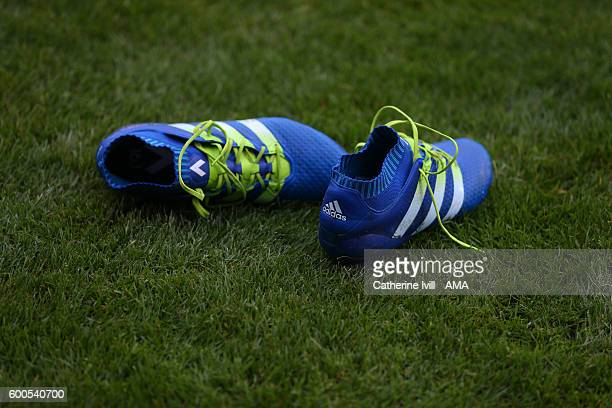 Pair of blue adidas boots lie on the pitch during the UEFA European U21 Championship Qualifier Group 9 match between England U21 and Norway U21 at...