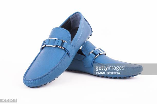 pair of blue male leather loafers isolated on white background - loafer stock pictures, royalty-free photos & images