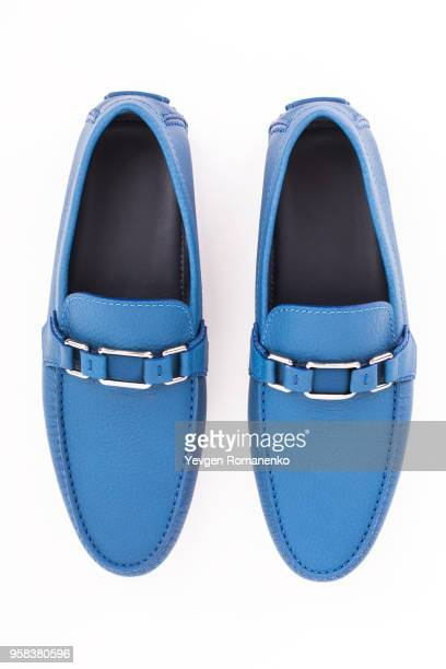 pair of blue male leather loafers isolated on white background - blue shoe stock pictures, royalty-free photos & images