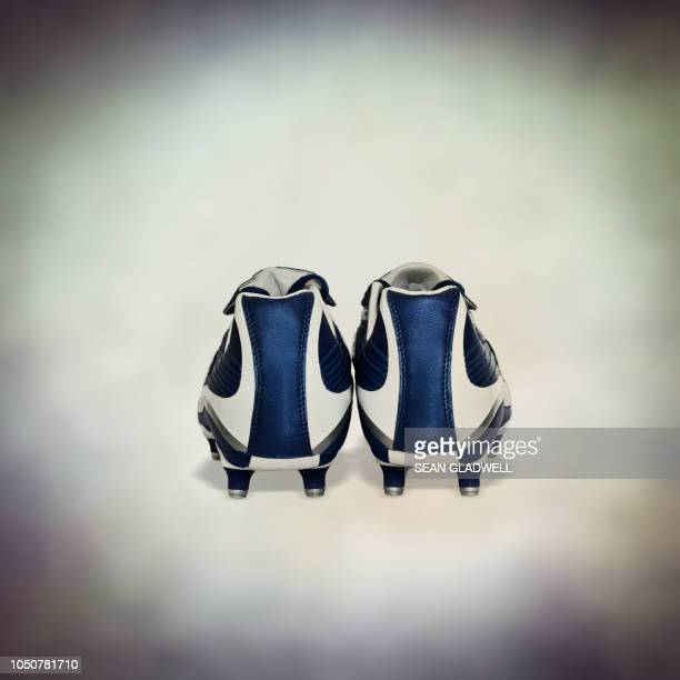 pair of blue soccer boots - cleats stock pictures, royalty-free photos & images