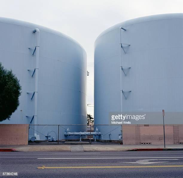 pair of blue storage tanks - estação de tratamento de esgotos imagens e fotografias de stock
