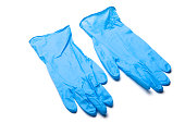 Pair of blue surgical gloves laying on white background