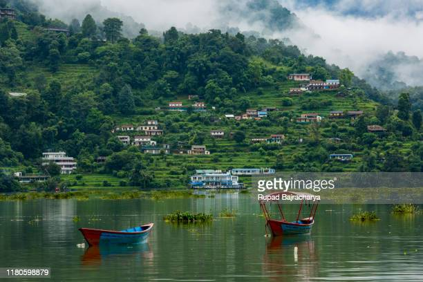 pair of boats ... - pokhara stock pictures, royalty-free photos & images
