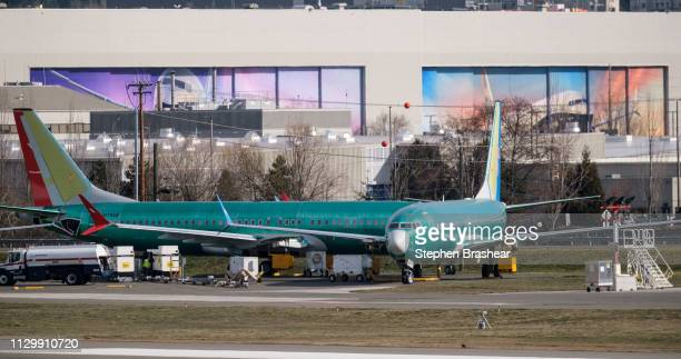 A pair of Boeing 737 MAX airplanes sit outside the company's factory on March 11 2019 in Renton Washington Boeing's stock dropped today after an...