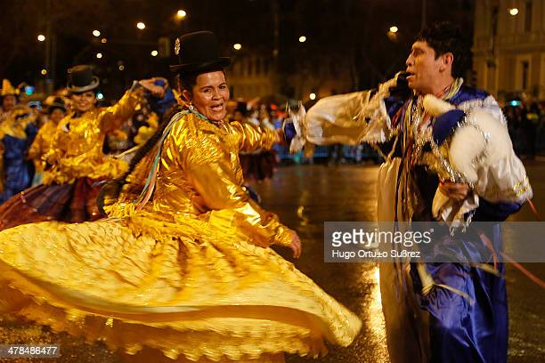 Pair of Bolivian dancers perform a traditional dance during opening of the Madrid Carnival. Thousands of people attended the beginning parade of the...