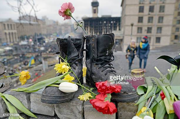 A pair of boots placed as a memorial to an anti Yanakovych protester killed in clashes with riot police last week on February 25 2014 in Kiev Ukraine...
