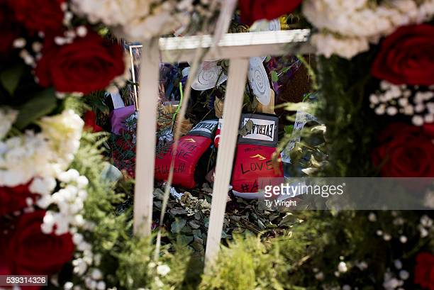 A pair of boxing gloves are placed on a memorial at the Muhammad Ali Center on June 10 2016 in Louisville Kentucky After the funeral and the eulogy...