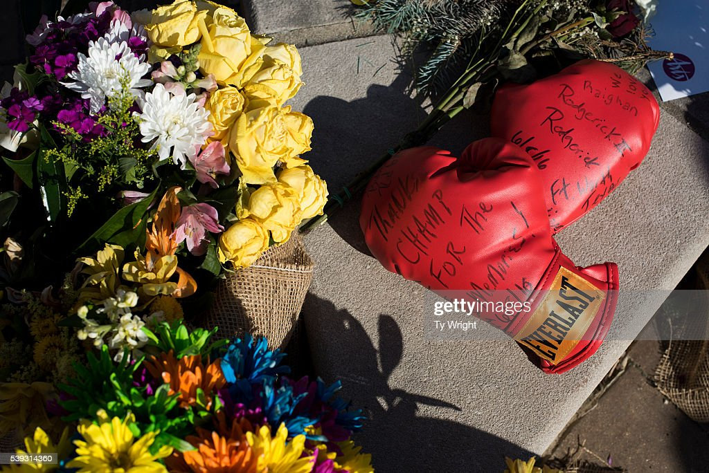 A pair of boxing gloves are placed on a memorial at the Muhammad Ali Center on June 10, 2016 in Louisville, Kentucky. After the funeral and the eulogy, people reconvened at the Muhammed Ali Center to celebrate the life of the iconic sports figure.