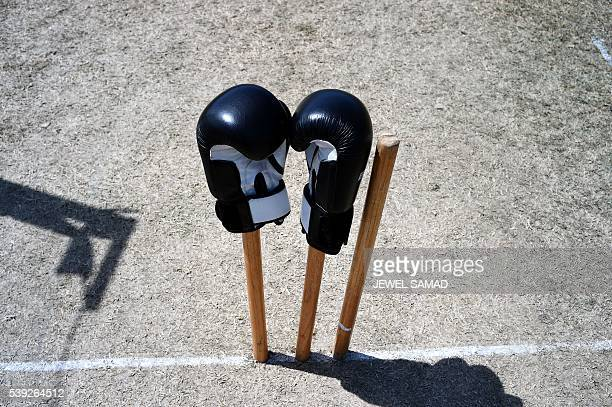 A pair of boxing gloves are placed on the stumps to pay respect to late boxer Muhammad Ali during West Indies cricket team's practice session in...