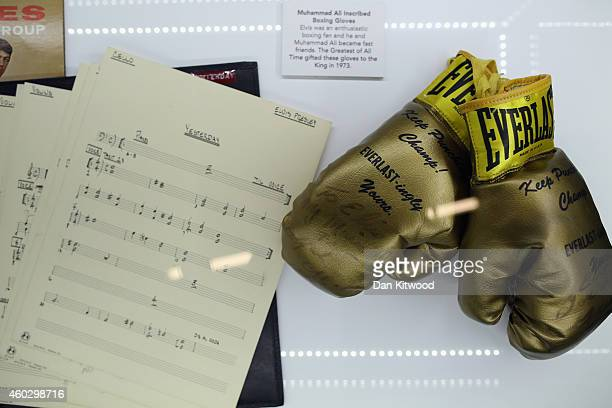 A pair of boxing gloves presented to Elvis Presleys by Muhammad Ali in 1963 are is displayed during a press call at the 'Elvis at the O2 The...