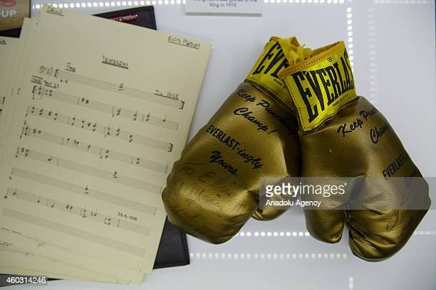 A pair of boxing gloves presented to Elvis Presleys by Muhammad Ali in 1963 are displayed during a press call at the 'Elvis at the O2 The Exhibition...