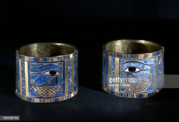 Pair of bracelets found on Shoshenq IIs body with representations of the Wedjat eye upon a basket The eyes are depictions of the eyes of the god...