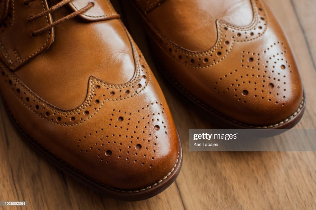 A pair of brown derby shoes with full brogue : Stock Photo