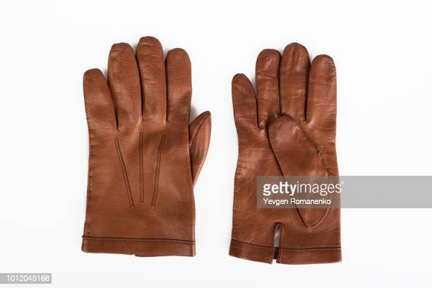 pair of brown leather gloves - brown glove stock pictures, royalty-free photos & images