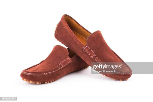 pair of brown leather loafers isolated on white background - suede shoe stock pictures, royalty-free photos & images