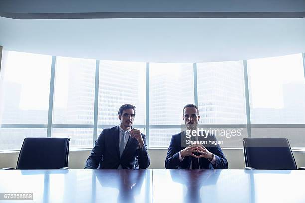 Pair of businessmen sitting at conference table