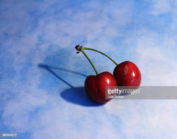 a pair of cherries - pair stock pictures, royalty-free photos & images
