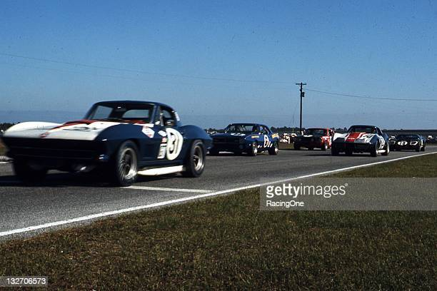 A pair of Chevrolet Corvettes race against a Chevrolet Camaro Ford Mustang and a Ford GT40 during the 24 Hours of Daytona at Daytona International...