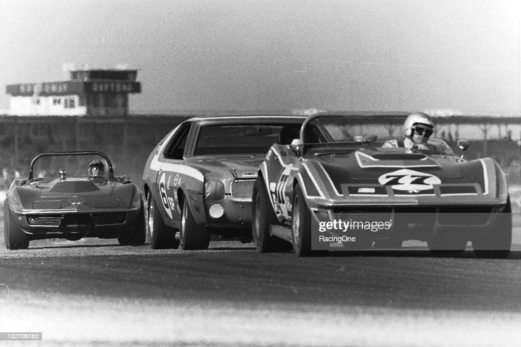 A pair of Chevrolet Corvettes sandwich an AMC Javelin during SCCA racing at Daytona International Speedway.